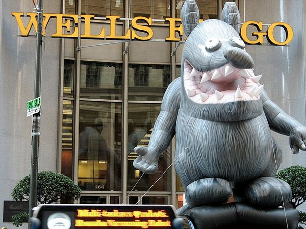 Wells Fargo with a inflatable big rat in front of it