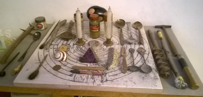 Altar with spoons, crystals, candles